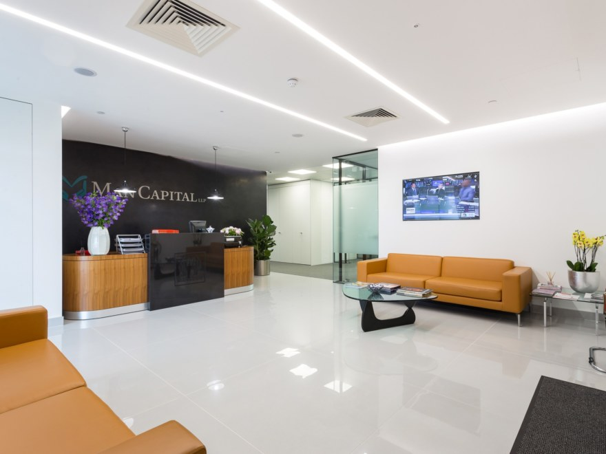 Fast track office reception design for Man Capital